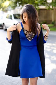 A black jacket and a blue embellished fit and flare dress feel perfectly suited for weekend activities of all kinds.  Shop this look for $41:  http://lookastic.com/women/looks/gold-ring-and-blue-skater-dress-and-black-blazer-and-black-bracelet/3409  — Gold Statement Ring  — Blue Embellished Skater Dress  — Black Blazer  — Black Statement Bracelet