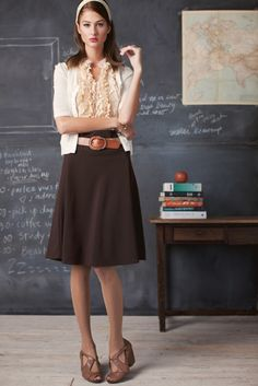 school girl outfits are so in. and sexy. brown medium heels, white headband, white 3/4 sleeve cardigan, brown waist belt, dark brown a line waist high knee length skirt, peach cream off white ruffle front blouse