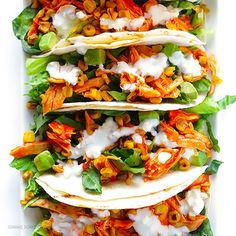 BUFFALO CHICKEN TACOS By @gimmesomeoven INGREDIENTS: 1 (15-ounce) can whole kernel corn 3 cups shredded cooked chicken ⅔ cup buffalo sauce 1 package Old El Paso Small Flour Tortillas or Stand & Stuff Tortillas 4 cups shredded Romain