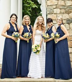 Navy bridesmaid dresses | Photo by JAGstudios