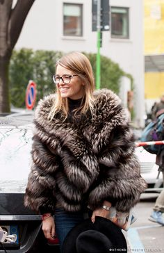 the woman is 27 types of cool. #CarlottaOddi & her awesome fur in Milan.