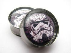 Stormtrooper star wars Plugs 0g, 00g, 7/16, 1/2, 9/16, 5/8, 3/4, 7/8 inch. $18.95, via Etsy.