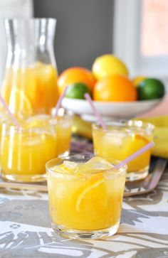 Sunshine Dazzler: 1 part vodka, 1 part orange juice, 1 part mango juice, 2 parts dry champagne, ice and orange slices to garnish.