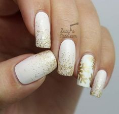 Festive White and Gold Snowflake Nails.