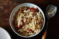 Southern Slow Cooker Choucroute : Green Cabbage, Onion, Apples, Bacon Grease, Garlic, Bay Leaf, Juniper Berries, Cider Vinegar, Brown Sugar, Mustard, Caraway, Smoked Sausage
