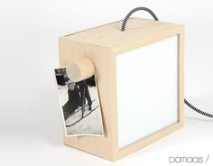 """""""LM BOX"""" Lamp by Ane Kristine Stafne Domaas. A metal structure covered with birch wood, characterized by two large writable lighting surfaces that make it versatile and ready to satisfy different needs, also equipped with several magnets to create additional functions, attach notes, photos and small items."""