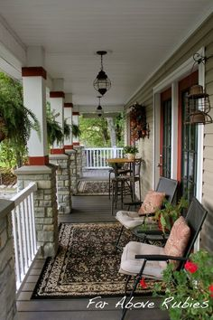 Front porch decor. I love the use of area rugs outside!