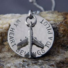 Hey, I found this really awesome Etsy listing at http://www.etsy.com/listing/100321186/my-heart-belongs-to-a-pilot-handstamped