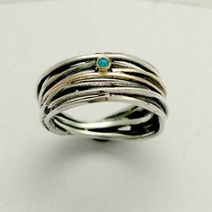 Sterling silver wrapped band mixed gold with blue opal - Good times.