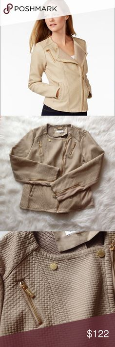 Like new Calvin Klein tan faux leather Moto jacket Perfect condition XL Calvin Klein Moto jacket, very attractive fitting on. Has gold zipper trimmings. No flaws everything is picture perfect Calvin Klein Jackets & Coats