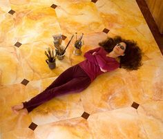 The stunning floor below is plywood that's been hand-painted in a faux marble finish.  Read about the process at PaintYoga.com