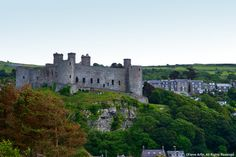 Explore a Medieval Fortress - Harlech Castle: Harlech Castle sits high on an almost vertical rock overlooking the sea.