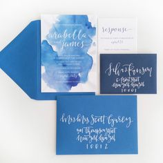 Gorgeous blue watercolor invitations with crisp white lettering that mimics calligraphy - perfect for a breezy wedding by the coast, or destination weddings.