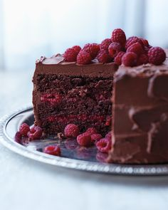 Chocolate-Raspberry Cake Martha Stewart Living - This beauty is baked with a splash of Chambord and layered with a sweet raspberry filling, both of which offer bright counterpoints to the thick layer of chocolate-cream cheese frosting and whole berries Just Desserts, Delicious Desserts, Dessert Recipes, Frosting Recipes, Chocolate Raspberry Cake, Cake Chocolate, Chocolate Cake Raspberry Filling, Raspberry Desserts, Decadent Chocolate
