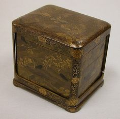 Tiered Box with Design of Autumn Grasses, Meiji iperiod, 1868-1912, Japan.  Gold and silver maki-e on black lacquer
