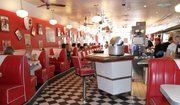 Liverpool's Rockafellas 50s diner. Red leatherette booths, memorabilia, driving Rock n' Roll and quality burgers, fries and shakes served by satin jacket-clad waitresses.