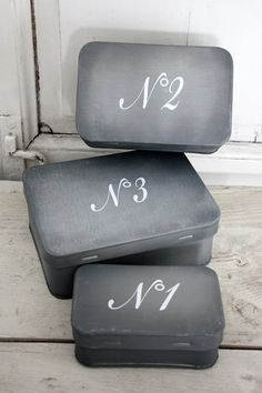 Use altoid tins. I am convinced that paint and vinyl letters can make anything look good.