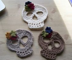 Crafts / crochet skulls - utterly sweet. I would lose the flowers and use them for hot pots and pans at the dinner table.