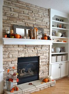 Seasonal: pumpkins, birch branches, faux leaves, modern candle holders and a mirror