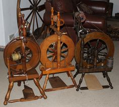 If these ever need a home, I'm open for adopting all three.  Three upright spinning wheels. by Dorothy L, via Flickr.