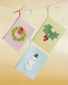 Button shapes resemble many seasonal things, as on these simple cards made of folded card stock. Construction paper cut-outs and a snip of ribbon help turn green buttons into a wreath, tiny red ones into holly berries, and white ones into a friendly snowman. (When they're turned vertically, the holes in the snowman's belly button look like buttons themselves.)
