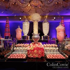 A wondrous wedding candy station holds seventy five containers of various sweet treats in shades of pink white and silver. #colincowie #CCCelebrations #teamcowie #dessert #wedding #macarons #weddingideas #pink #candybar via @angela4design