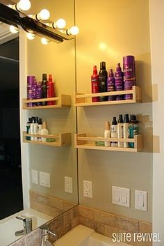 Spice racks for shelves in the bathroom  Couldn't find spice racks in our area so we improvised with a plastic shelf, love it still though!