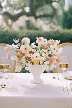 """From the editorial """"Sunset on the Seine by Claude Monet Inspired This Spring Wedding Editorials Color Palette."""" The mix of warm and cool pastel tones played out so beautifully in Moonstruck Florals arrangements.  Photography: @lisasilvaphotography  #floralarrangements #weddingflowers #weddingfloraldesign #weddingreceptiontable"""