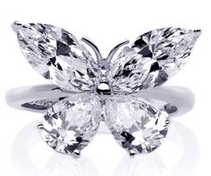 Mixed Cut Butterfly Diamond Ring 1 carat total weight in 14K White Gold....man if I was rich! I love butterflies