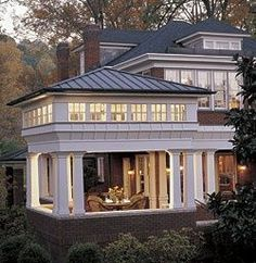 Capping a porch with a clerestory and a pyramid roof adds up to an outdoor space that becomes a giant lantern at night.