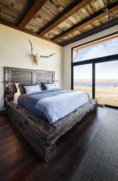 Rustic king bed frame, barn wood head board, antlers, sliding glass door, modular living, barn wood ceiling