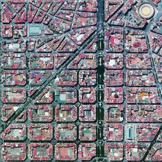 1/6/2015 L'Eixample Valencia, Spain   The urban plan of the L'Eixample district in Valencia, Spain is characterized by long straight streets, a strict grid pattern crossed by wide avenues, and apartments with communal courtyards. A similar layout was used for the district of the same name in Barcelona. The circular structure in the upper right is the Plaza de Toros de Valencia - the city's largest bullfighting arena.
