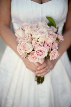 Bride in white holding a simple yet beautiful light pink rose bouquet - photo by Houston based wedding photographer Adam Nyholt