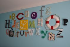 ABC wall: Have a bunch of dinner parties where guests bring in a picture or a thing in the shape of a letter. Great idea for a baby's room?