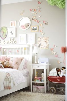 Cute little girl's room - how pretty are those butterflies!