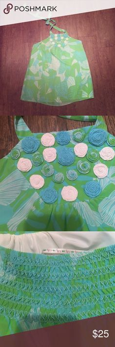 Lilly silk halter- size 10 Beautiful silk Lilly halter in pristine condition. Has stretch back so could fit a 12 or someone with a large chest. Love the palm leaf print. Perfect with white jeans and wedges for summer. Priced to sell on merc: gennyl Lilly Pulitzer Tops Blouses