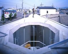 House S by Suga Atelier - WTF this is a protective wall, not a house! Is the urban landscape that ugly so that you cant have one single window viewing the outside?