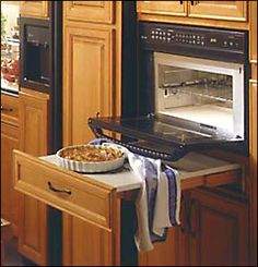 pull out tabletop drawer under stove for setting plates   *I'VE DONE THIS WITH STANDARD DRAWERS, EITHER SETTING THINGS RIGHT IN THE DRAWER ITSELF OR PUTTING A CUTTING BOARD OR SOMETHING SIMILAR OVER THE DRAWER, NO SPECIAL CONSTRUCTION NEEDED.. (TAG: WHEELCHAIR ACCESSIBLE UNIVERSAL DESIGN)