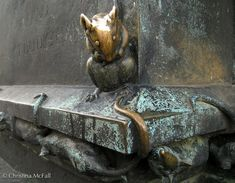 detail of rats on statue of St Gertrude in Berlin