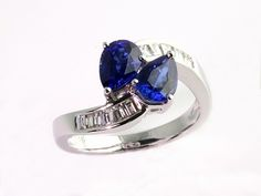 Gem of a Gift Idea #22:  Pear-shape Blue Sapphire and Diamond Bypass Ring in 18k.  Features a unique curved shank which sits beautifully on her finger!  $3450 (at Seven Fields)  Moses Jewelers | | 7f-050268
