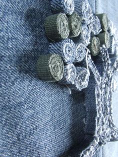 Rolled up denim pieces to make art project Gloucestershire Resource Centre http://www.grcltd.org/scrapstore/