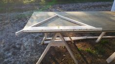 first I laid out the pentagon on a sheet of plywood. It is drawn out with a pencil. I laid the 3 struts along those lines. very carefully. Next I cut 2x4s to lay inside the struts to keep them in place. everything is clamp down to keep them from moving. I have 6 small bar clamps but I will be getting a few more today. You can't have to many clamps.