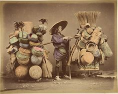 """[Japanese Man Posing with Baskets, Brooms and Feather Dusters]. Date: 1870s. """"Smallware & Basket peddler"""""""