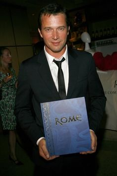 James Purefoy poses with the official 'Rome' book at a cocktail reception to celebrate the DVD release of the beloved 'HBO' series