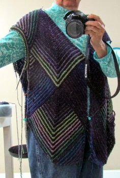 This garter stitch jacket is done in modules, with very little sewing required. Almost any combination of yarns is possible, b...