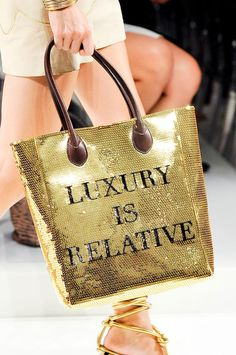 "Absolutely love this Moschino ""Luxury is relative"" gold bag <3 Perfect for a day with the girls x Anushree #NYMI"