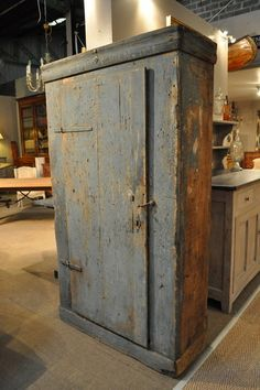 A Primative Blue Painted Armoire from about 1850 From FarFetchers.com