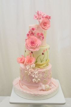 Stunning Wedding Cake ~ gumpaste double impatients, bougainvilleas oleanders and hydrangeas. The second tier is hand painted