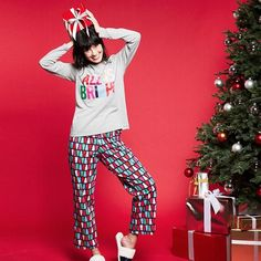 """Cute holiday pajamas for women. Holiday comfort. Long-sleeve tee with """"All Is Bright"""" logo with graphic print. Long pants with multicolor tree print. Top, 24"""" on M and 25.5"""" on 1X; pant inseam, 28.5"""" for missy and 29.5"""" for plus size.FEATURES• Rounded neckline"""