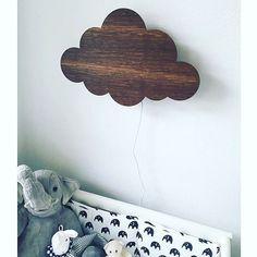 ferm LIVING Cloud lamp in smoked oak: http://www.fermliving.com/webshop/search/kids-room/cloud-lamp-smoked-oak.aspx